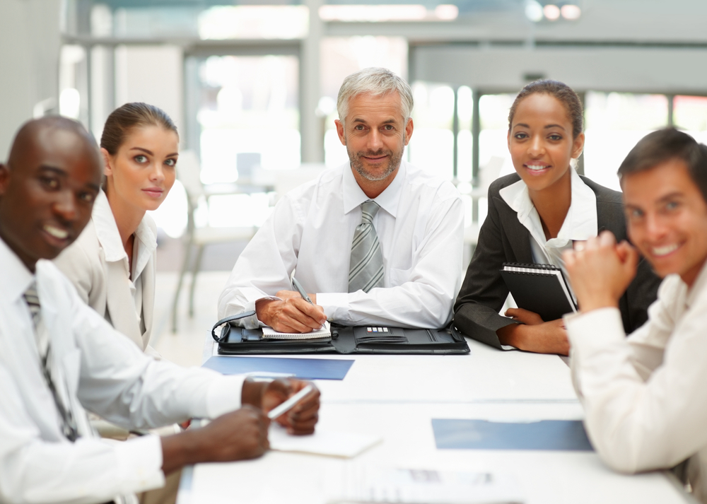 shutterstock-smiling-business-meeting